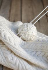 Beautiful white knitting with needles