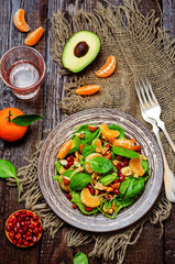 Spinach tangerines pomegranate avocado almonds walnuts salad