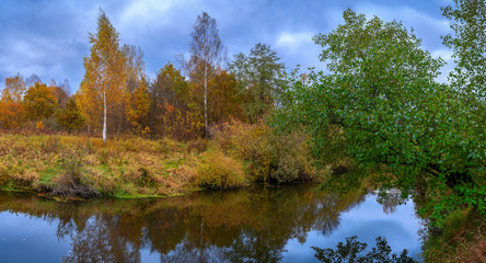Beautiful autumn river landscape with colorful trees