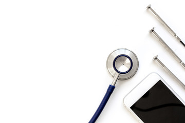 diagnostic of gadgets on white background with stethoscope top view