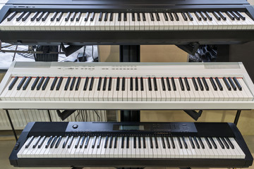 Stand with electric piano in the store
