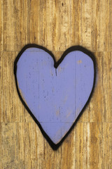 Purple heart painted on a tiled wall