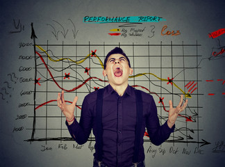 man frustrated with financial results performance report