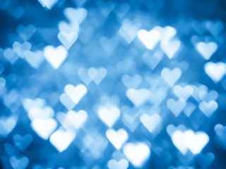 Blue heart bokeh Christmas light holiday background.