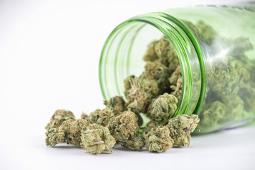 Detail of cannabis buds (ob reaper strain) on green glass jar is