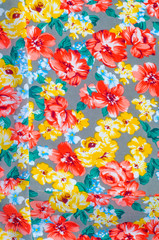 texture silk cloth. Yellow red flowers painted on cloth