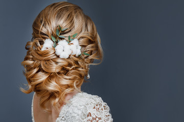 Fotorolgordijn Kapsalon beauty wedding hairstyle decorated with cotton flower, rear view