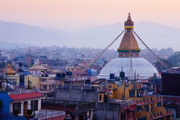 Kathmandu city view on the early morning before sunrise with famous buddhist Boudhanath Stupa temple. Tibetan traditional architecture, Nepal.