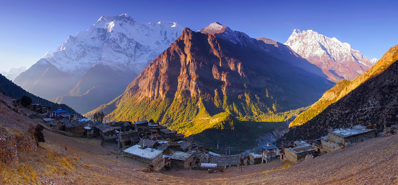 Horizontal Panoramic mountain view of Ghyaru village, Mountain Annapurna II and IV summits, in Pisang area, on Annapurna Circuit Trek, in Annapurna Himal, Himalaya, Nepal, Asia