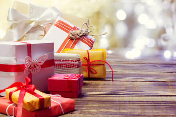 gifts on a wooden background with bokeh