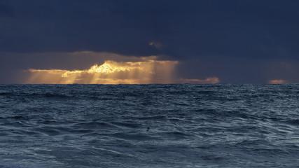 Autumn orange sea sunset before storm