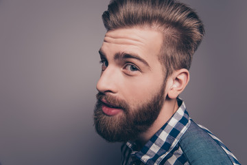 Closeup portrait of funny glad hipster bearded man looking at ca