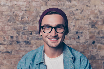 Portrait of handsome  hipster man in violet cap and glasses