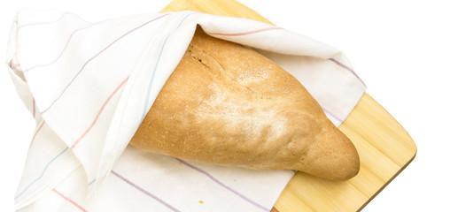 Wheat bread on a linen towel