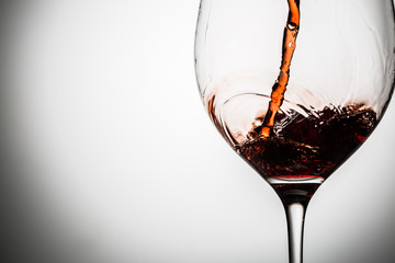 Studio photo of wine poured into goblet on blank background