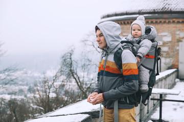 Family walking in Ljubljana, Slovenia at winter time.