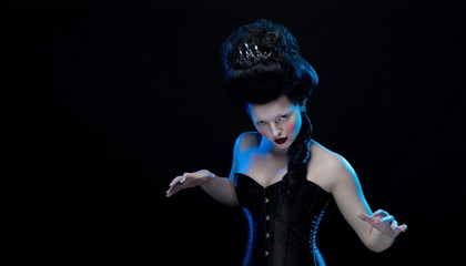 brunette woman with high hair and a corset in old style on a black background