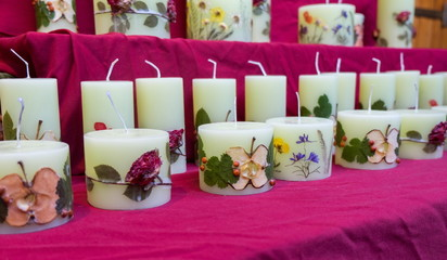 handmade candles with fruit slices and flowers for sale at chris