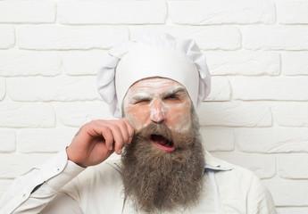 Frown man cook twirls moustache