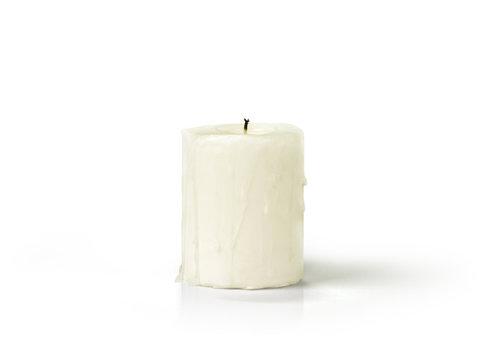 Extinguished candle isolated on white background