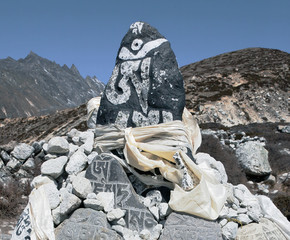 Ancient stones carved with the buddhist mantras near Dingboche -