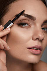 Beautiful Woman With Fresh Makeup And Brush For Eyebrows