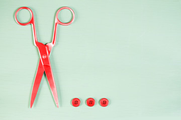 Pop art. Scissors and buttons on close up on wooden board