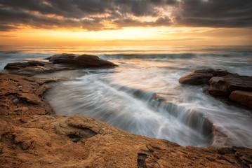 Fototapeta Rocky sunrise / A beautiful view with first rays at a rocky Black Sea coast, Bulgaria obraz