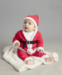 Caucasian baby in Santa Clothes isolated inside studio