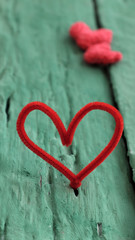 valentine red heart on green background