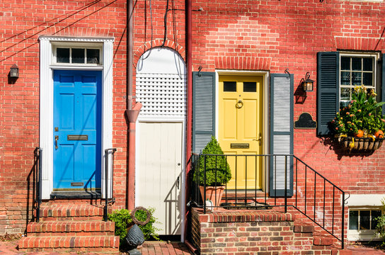 Colourful Wooden Doors on an Brick Building