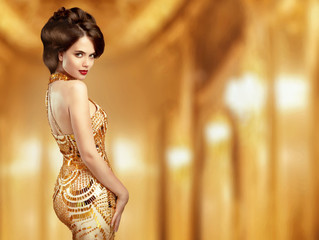 Beautiful fashion woman in gold dress, elegant lady in expensive