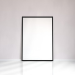 Mock up blank poster picture frame near the wall in a room, 3D rendering
