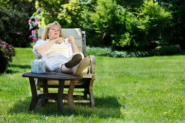 Seasonal allergies - Mature woman about to blow her nose