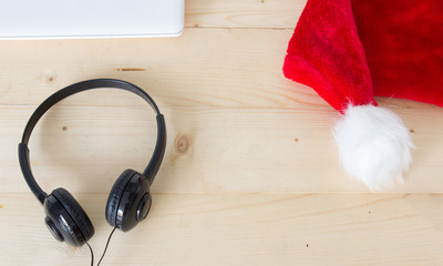 Red Christmas hat with headphone , Merry Christmas song