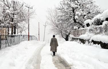 A man walking through snow