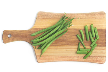 Green Beans Pods over a wooden board. Slim