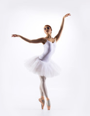 Young beautiful ballet dancer on a white background
