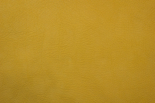 Yellow leather artificial texture background