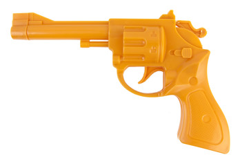 Isolated orange plastic toy gun.