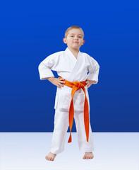 Boy in karategi on a blue background