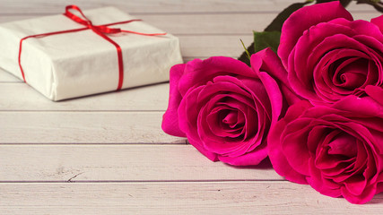 Romantic composition with rose flowers and gift St. Valentines Day background