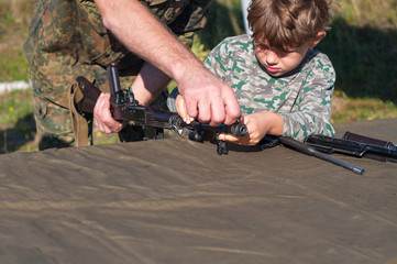 Boy studying military science - components of weapons