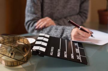Artist screenwriter desktop detail clapper board