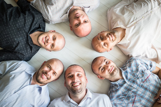 Group portrait of young bald men