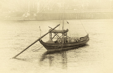 Traditional boats with wine barrels in Porto, Portugal (stylized retro)