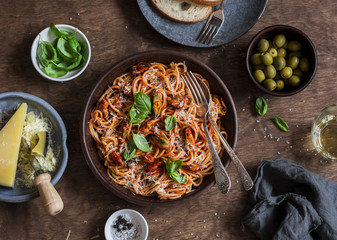 Healthy delicious lunch - spaghetti with tomato sauce and mussels on a wooden table, top view. Flat lay Wall mural