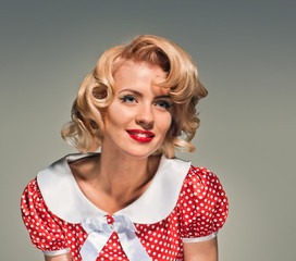 smiling retro blonde pinup woman