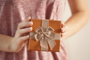 Female hands holding gift box, closeup