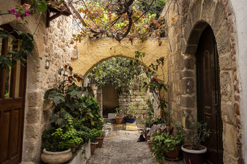 Medieval arched backstreet in the old town of Rhodes, Greece
